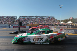 Ashley Force Hood competes against Cruz Pedregon during round 1