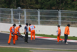 The Marshalls clean the track at the last corner