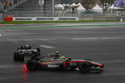 Jarno Trulli, Lotus F1 Team and Bruno Senna, Hispania Racing F1 Team