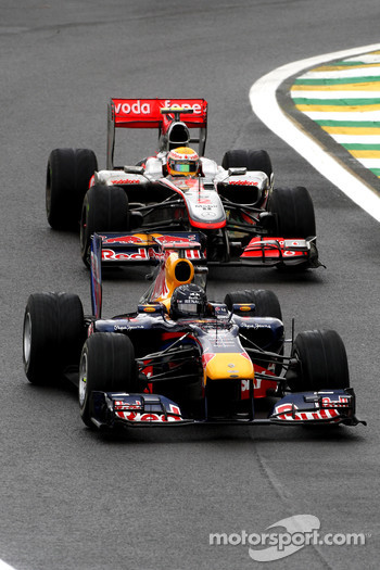 Sebastian Vettel, Red Bull Racing leads Lewis Hamilton, McLaren Mercedes