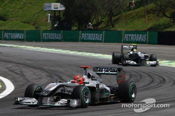 Michael Schumacher, Mercedes GP leads Nico Hulkenberg, Williams F1 Team