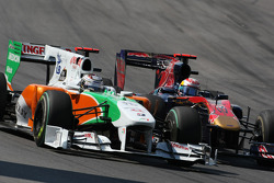 Adrian Sutil, Force India F1 Team and Sebastien Buemi, Scuderia Toro Rosso