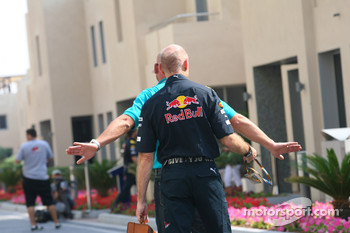 Adrian Newey, Red Bull Racing, Technical Operations Director being told by paddock security to wear his F1 pass around his neck