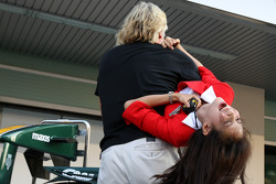 Sir Richard Branson, Virgin Group CEO, carries an air hostess