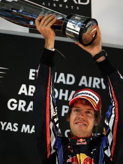 F1: Podium: race winner and 2010 Formula One World Champion Sebastian Vettel, Red Bull Racing, celebrates