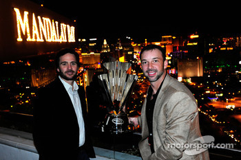 Five-time NASCAR Sprint Cup Series Champion Jimmie Johnson and crew chief Chad Knaus pose with the 2010 trophy at the House of Blues Foundation Room inside Mandalay Bay Resort & Casino