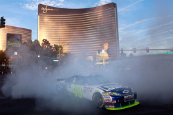 Jimmie Johnson does a burnout during the NASCAR Sprint Cup Series Champions Week Victory Lap outside of the Wynn Las Vegas Hotel