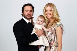 Five-time champion Jimmie Johnson poses with their daughter Genevieve Marie and his wife Chandra