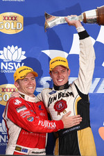 Lee Holdsworth celebrates taking out the race win with 2010 V8 Supercars Champion James Courtney