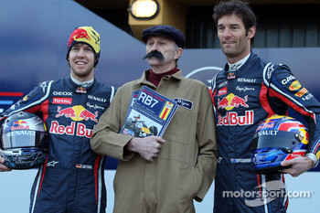 Sebastian Vettel Red Bull Racing and Mark Webber Red Bull Racing with a Haynes manual mechanic
