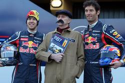 Sebastian Vettel Red Bull Racing and Mark Webber Red Bull Racing with a Haynes manual mechanic