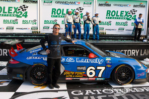 Team owner Kevin Buckler celebrates 2011 Daytona24 GT victory