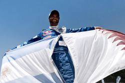 Car category winner Nasser Al Attiyah celebrates