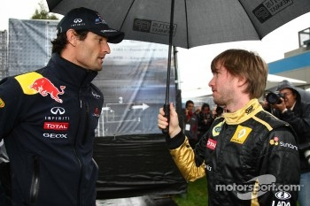 Mark Webber, Red Bull Racing and Nick Heidfeld, Lotus Renault GP