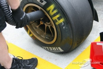 The Pirelli tyre of Nick Heidfeld, Lotus Renault GP after his brake locked up for most of a lap