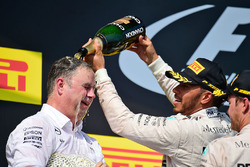 Ron Meadows, Mercedes GP Team Manager celebrates on the podium with Lewis Hamilton, Mercedes AMG F1 and Nico Rosberg, Mercedes AMG F1
