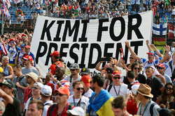 Kimi for President banner with fans at the podium