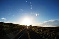 Road racing Photos - Dougie Lampkin with Wheelie around Isle of Man