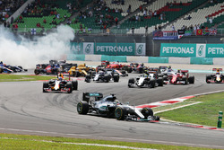 Lewis Hamilton, Mercedes AMG F1 W07 Hybrid leads at the start of the race as team mate Nico Rosberg, Mercedes AMG F1 W07 Hybrid recovers from a collision
