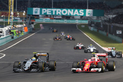 (L to R): Sergio Perez, Sahara Force India F1 VJM09 and Kimi Raikkonen, Ferrari SF16-H battle for position
