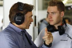 Stoffel Vandoorne, McLaren Test and Reserve driver talks to Jost Capito, McLaren chief executive