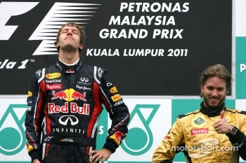 Podium: race winner Sebastian Vettel, Red Bull Racing, third place Nick Heidfeld, Lotus Renault F1 Team