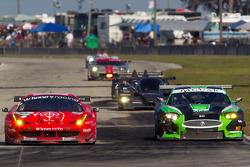 #59 Luxury Racing Ferrari F458 Italia: Stéphane Ortelli, Frederic Makowiecki, Jean-Denis Deletraz, #098 Jaguar RSR Jaguar XKR: P.J. Jones, Rocky Moran, Ken Wilden