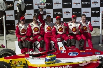 Race winner Sbastien Bourdais celebrates with his crew