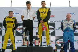 Podium: race winner Justin Wilson with A.J. Allmendinger, Carl Russo and Paul Tracy