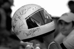 Drivers sign autographs on an helmet