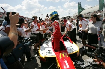 Pole winner Sbastien Bourdais celebrates