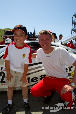 #20 Ferrari of Houston Ferrari 458 Challenge: Cooper MacNeil with a young fan