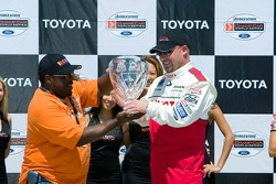 Todd Bodine accepts his trophy from Cedric The Entertainter