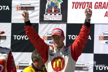 Podium: race winner Sbastien Bourdais celebrates