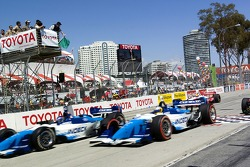 Paul Tracy gets the jump on Mario Dominguez at the green flag