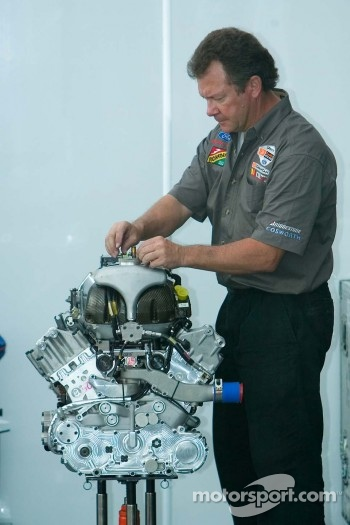 CTE Racing - HVM mechanic works on a Cosworth V8 engine