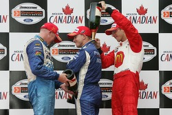 Podium: champagne for A.J. Allmendinger, Paul Tracy and Sébastien Bourdais