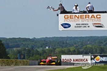 Race winner Sébastien Bourdais takes the checkered flag