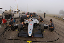 Pacific Coast Motorsports team members practice pit stops