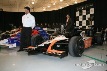 Michael Andretti stands next to the No. 1 Jim Beam Vonage Dallara Honda Firestone that he will drive in the 2006 Indianapolis 500