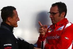 Michael Schumacher, Mercedes GP F1 Team talks with Stefano Domenicali Ferrari General Director