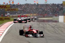 Fernando Alonso, Scuderia Ferrari leads Jenson Button, McLaren Mercedes