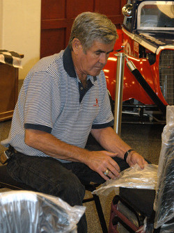 Al Unser, Sr. unwrapping chairs