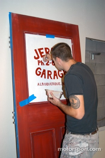 Painting of false window for Jerry's Garage office door