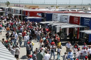 Fans crowd the paddock