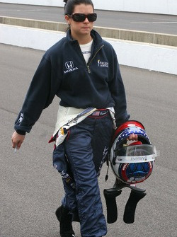 Danica Patrick walks down the pit lane to practice