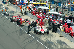 Helio Castroneves leaves as Dan Weldon arrives, nearly a lap ahead
