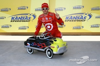 Pole winner Dan Wheldon with his prize