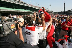 Helio Castroneves celebrates after his pole winning run