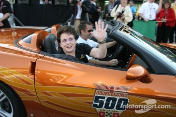 Honorary Starter, Billie Jean King, reacts after taking a ride around the famed two and a half mile oval in the Chevrolet Corvette Pacecar